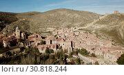 Купить «Aerial view of Albarracin - medieval town with fortress wall on hillside, Spain», видеоролик № 30818244, снято 26 декабря 2018 г. (c) Яков Филимонов / Фотобанк Лори