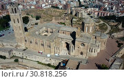 Купить «Panoramic view from drone of Catalan city of Lleida with medieval Cathedral of St. Mary of La Seu Vella», видеоролик № 30818256, снято 25 июля 2018 г. (c) Яков Филимонов / Фотобанк Лори