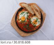 Купить «Fried eggs with tomato sauce», фото № 30818608, снято 27 марта 2019 г. (c) Алексей Кокорин / Фотобанк Лори