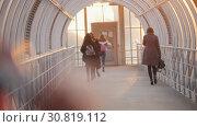 Купить «Young women fast run across the overhead passage», видеоролик № 30819112, снято 3 апреля 2020 г. (c) Константин Шишкин / Фотобанк Лори