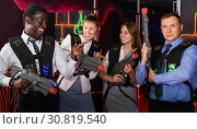 Купить «males and females in business suits posing at laser tag room», фото № 30819540, снято 4 апреля 2019 г. (c) Яков Филимонов / Фотобанк Лори