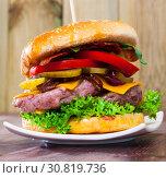 Купить «American double cheeseburger», фото № 30819736, снято 9 сентября 2019 г. (c) Яков Филимонов / Фотобанк Лори