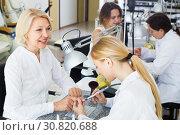 Купить «Young women doing manicure», фото № 30820688, снято 2 ноября 2016 г. (c) Яков Филимонов / Фотобанк Лори