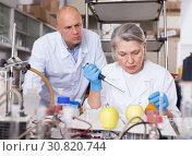 Купить «Biochemists checking fruits and vegetables», фото № 30820744, снято 24 января 2019 г. (c) Яков Филимонов / Фотобанк Лори