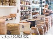 Купить «Image of showcase with dried fruits and nuts in container», фото № 30821032, снято 4 сентября 2017 г. (c) Яков Филимонов / Фотобанк Лори