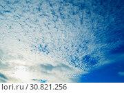 Купить «Sunset colorful sky background - blue dramatic colorful clouds lit by evening sunshine», фото № 30821256, снято 15 октября 2015 г. (c) Зезелина Марина / Фотобанк Лори