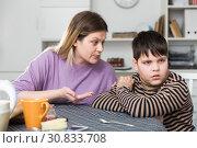 Купить «Upset boy and angry mother having quarrel during breakfast at home», фото № 30833708, снято 9 февраля 2019 г. (c) Яков Филимонов / Фотобанк Лори