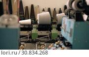 Купить «Spools of thread on knitting machine video», видеоролик № 30834268, снято 25 мая 2019 г. (c) Гурьянов Андрей / Фотобанк Лори
