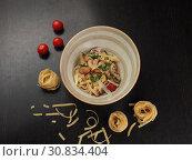 Купить «Spaghetti with cheese in a plate on the table», фото № 30834404, снято 8 мая 2019 г. (c) Алексей Кокорин / Фотобанк Лори