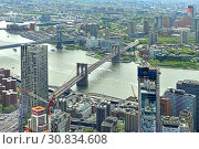 Купить «View of New York City. East River, Manhattan Bridge and Brooklyn Bridge, Manhattan is on left, Brooklyn on right», фото № 30834608, снято 8 мая 2019 г. (c) Валерия Попова / Фотобанк Лори