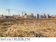 Купить «Construction site on a wasteland», фото № 30838216, снято 20 апреля 2019 г. (c) Дмитрий Тищенко / Фотобанк Лори