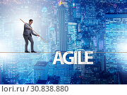 Купить «Agile transformation concept with businessman walking on tight r», фото № 30838880, снято 2 июня 2020 г. (c) Elnur / Фотобанк Лори