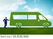 Купить «Businessman with green ecological vehicle», фото № 30838900, снято 24 августа 2019 г. (c) Elnur / Фотобанк Лори