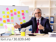 Купить «Aged man employee in conflicting priorities concept», фото № 30839640, снято 25 декабря 2018 г. (c) Elnur / Фотобанк Лори
