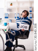 Купить «Young tied male employee in the office», фото № 30840308, снято 18 декабря 2018 г. (c) Elnur / Фотобанк Лори