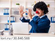 Купить «Young clown businessman working in the office», фото № 30840588, снято 14 декабря 2018 г. (c) Elnur / Фотобанк Лори