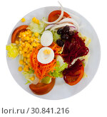 Купить «Mix salad with vegetables, prune, boiled beet and lettuce», фото № 30841216, снято 16 июня 2019 г. (c) Яков Филимонов / Фотобанк Лори