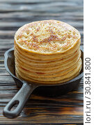 Купить «Stack of pancakes in a cast iron pan», фото № 30841800, снято 6 февраля 2018 г. (c) Марина Сапрунова / Фотобанк Лори