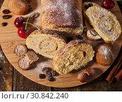 Купить «Sand nut chocolate cookies and rolled biscuit on board», фото № 30842240, снято 25 мая 2019 г. (c) Gennadiy Poznyakov / Фотобанк Лори
