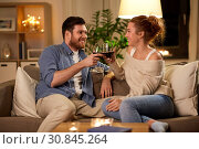 Купить «happy couple drinking red wine at home in evening», фото № 30845264, снято 5 января 2019 г. (c) Syda Productions / Фотобанк Лори