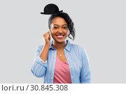 Купить «african woman with bowler hat party accessory», фото № 30845308, снято 2 марта 2019 г. (c) Syda Productions / Фотобанк Лори