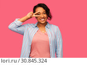 Купить «happy african american woman showing peace», фото № 30845324, снято 2 марта 2019 г. (c) Syda Productions / Фотобанк Лори