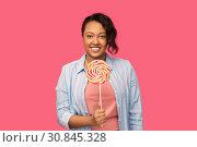 Купить «happy african american woman with big lollipop», фото № 30845328, снято 2 марта 2019 г. (c) Syda Productions / Фотобанк Лори