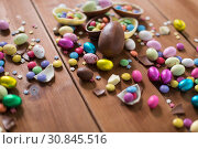 Купить «chocolate eggs and candy drops on wooden table», фото № 30845516, снято 22 марта 2018 г. (c) Syda Productions / Фотобанк Лори