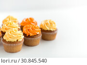 Купить «cupcakes with frosting on white background», фото № 30845540, снято 6 июля 2018 г. (c) Syda Productions / Фотобанк Лори