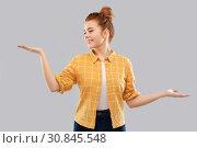 Купить «happy red haired teenage girl holding empty hands», фото № 30845548, снято 28 февраля 2019 г. (c) Syda Productions / Фотобанк Лори