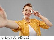 Купить «redhead teenage girl taking selfie making peace», фото № 30845552, снято 28 февраля 2019 г. (c) Syda Productions / Фотобанк Лори