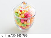 Купить «close up of glass jar with colorful candy drops», фото № 30845796, снято 6 июля 2018 г. (c) Syda Productions / Фотобанк Лори