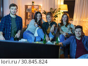 Купить «happy friends with drinks watching tv at home», фото № 30845824, снято 22 декабря 2018 г. (c) Syda Productions / Фотобанк Лори