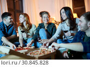 Купить «friends eating pizza and drinking red wine at home», фото № 30845828, снято 22 декабря 2018 г. (c) Syda Productions / Фотобанк Лори
