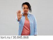Купить «african american woman over grey background», фото № 30845868, снято 2 марта 2019 г. (c) Syda Productions / Фотобанк Лори