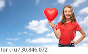 Купить «smiling teenage girl with red heart shaped balloon», фото № 30846072, снято 17 февраля 2019 г. (c) Syda Productions / Фотобанк Лори