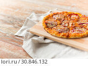 Купить «close up of homemade pizza on wooden table», фото № 30846132, снято 21 мая 2015 г. (c) Syda Productions / Фотобанк Лори