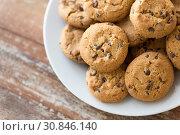 Купить «close up of oatmeal cookies on plate», фото № 30846140, снято 22 мая 2015 г. (c) Syda Productions / Фотобанк Лори