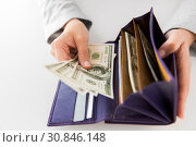 Купить «close up of woman hands with wallet and us money», фото № 30846148, снято 2 июля 2015 г. (c) Syda Productions / Фотобанк Лори
