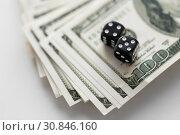 Купить «close up of black dice on dollar money», фото № 30846160, снято 30 июля 2015 г. (c) Syda Productions / Фотобанк Лори