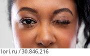Купить «close up of african american woman winking one eye», фото № 30846216, снято 2 марта 2019 г. (c) Syda Productions / Фотобанк Лори