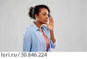 Купить «african american woman calling», фото № 30846224, снято 2 марта 2019 г. (c) Syda Productions / Фотобанк Лори