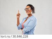 Купить «african student woman in glasses points finger up», фото № 30846228, снято 2 марта 2019 г. (c) Syda Productions / Фотобанк Лори