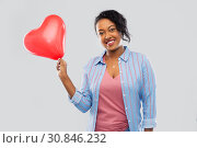 Купить «african american woman with heart-shaped balloon», фото № 30846232, снято 2 марта 2019 г. (c) Syda Productions / Фотобанк Лори