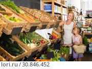 Купить «Portrait of glad young woman and girl shopping», фото № 30846452, снято 18 июня 2019 г. (c) Яков Филимонов / Фотобанк Лори