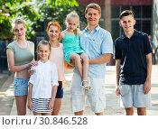 Купить «family walking in summer city», фото № 30846528, снято 1 апреля 2020 г. (c) Яков Филимонов / Фотобанк Лори
