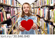 Купить «smiling teenage girl with red heart over library», фото № 30846840, снято 17 февраля 2019 г. (c) Syda Productions / Фотобанк Лори