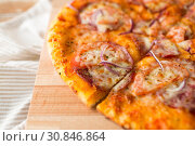 Купить «close up of homemade pizza on wooden table», фото № 30846864, снято 21 мая 2015 г. (c) Syda Productions / Фотобанк Лори