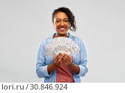 Купить «happy african american woman holding dollar money», фото № 30846924, снято 2 марта 2019 г. (c) Syda Productions / Фотобанк Лори