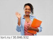 Купить «african american student woman with notebooks», фото № 30846932, снято 2 марта 2019 г. (c) Syda Productions / Фотобанк Лори
